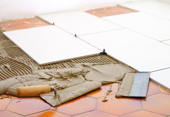 Can you tile over existing tiles?